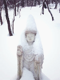 White marble Medicine Buddha in the snow